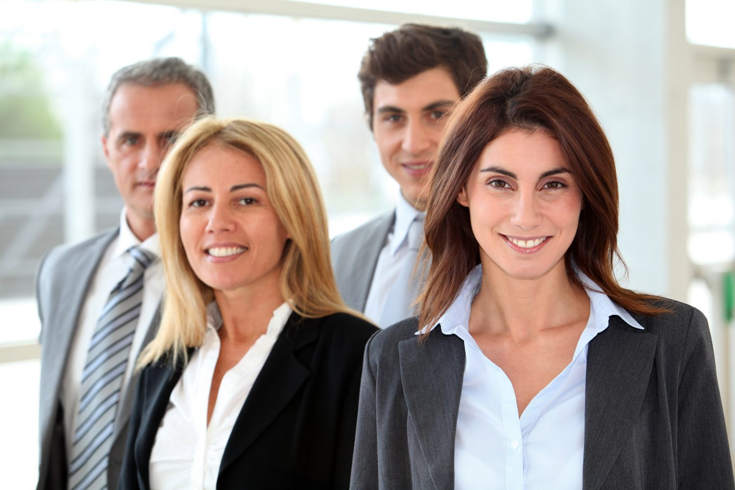 Small group of smiling business people